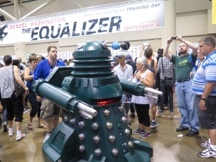 A dalek storms the crowd.